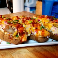 Super Loaded Buffalo Chicken Potato Skins